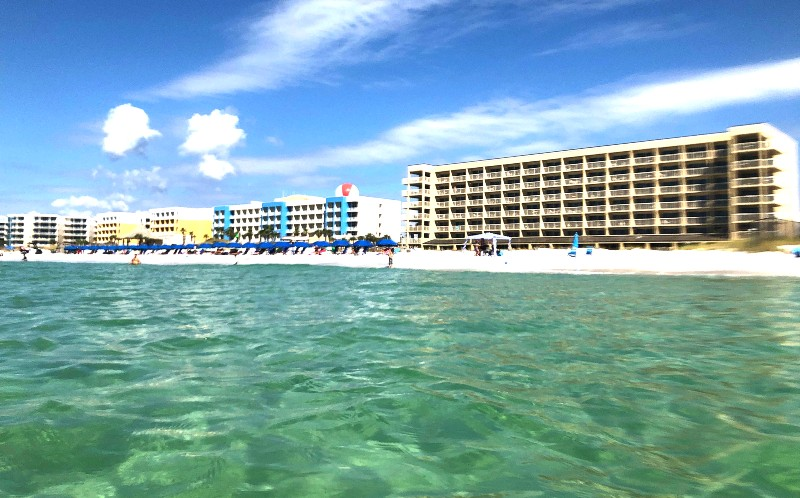 Hotel on a white-sand beach. Good for family vacations.